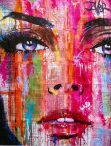 A colorful painting of a woman's face.